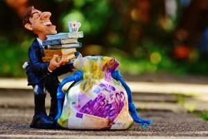 Banki zarabiają gigantyczne pieniądze na naszej niewiedzy